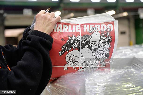 French satirical weekly Charlie Hebdo's second edition since the terrorist attack on the magazine in January is prepared at a press distribution...