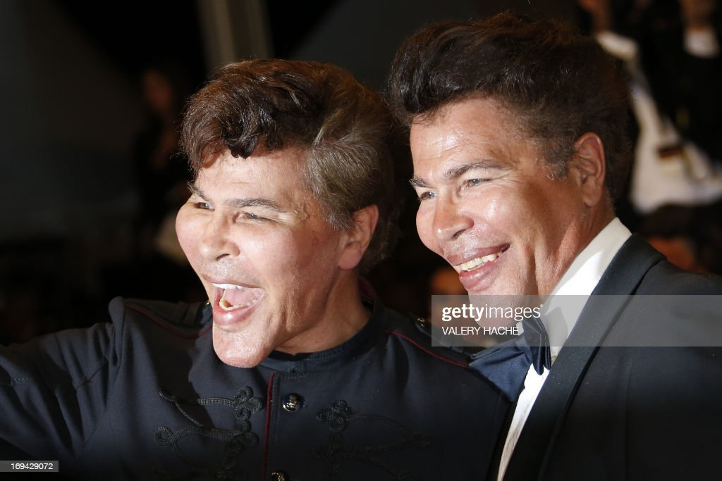 French scientific journalists Igor et Grichka Bogdanoff pose on May 24, 2013 as they arrive for the screening of the film 'Michael Kohlhaas' presented in Competition at the 66th edition of the Cannes Film Festival in Cannes. Cannes, one of the world's top film festivals, opened on May 15 and will climax on May 26 with awards selected by a jury headed this year by Hollywood legend Steven Spielberg. AFP PHOTO / VALERY HACHE
