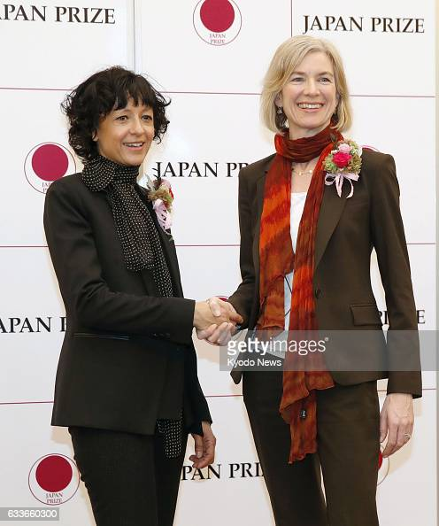 French scientist Emmanuelle Charpentier and US scientist Jennifer Doudna pose for photos in Tokyo on Feb 2 after the Japan Prize Foundation announced...