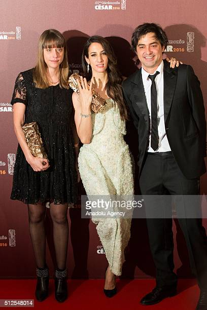 French screenwriter Alice Winocour Turkish Director Deniz Gamze Erguven and French producer and actor Charles Gillibert pose with the trophies after...