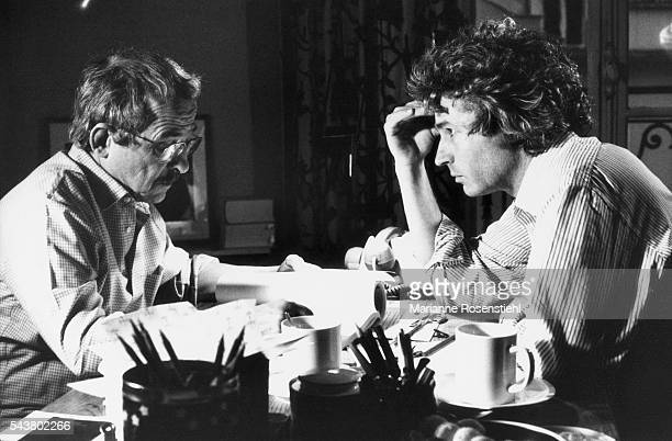 French screenwriter Gérard Brach and French director screenwriter and producer JeanJacques Annaud on the set of the film L'Ours