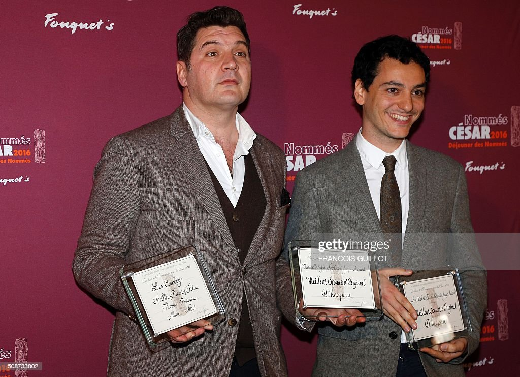 French screenwriter Thomas Bidegain (L) and French actor Noé Debré pose with their awards for Best Original Screenplay and Best First Feature Film during the nominations event for the 2016 César film awards, on February 6, 2016 in Paris. The 41st Ceremony for the Cesar film award, considered as the highest film honour in France, will take place on February 26, 2016. / AFP / FRANCOIS GUILLOT