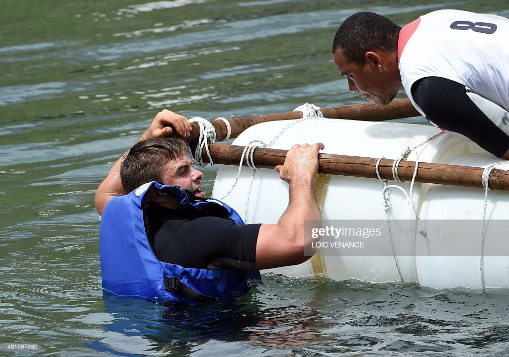 French scrum half Rory Kockott and French center Gael Fickou put their raft in the water during a contest as part of the French rugby union team's...