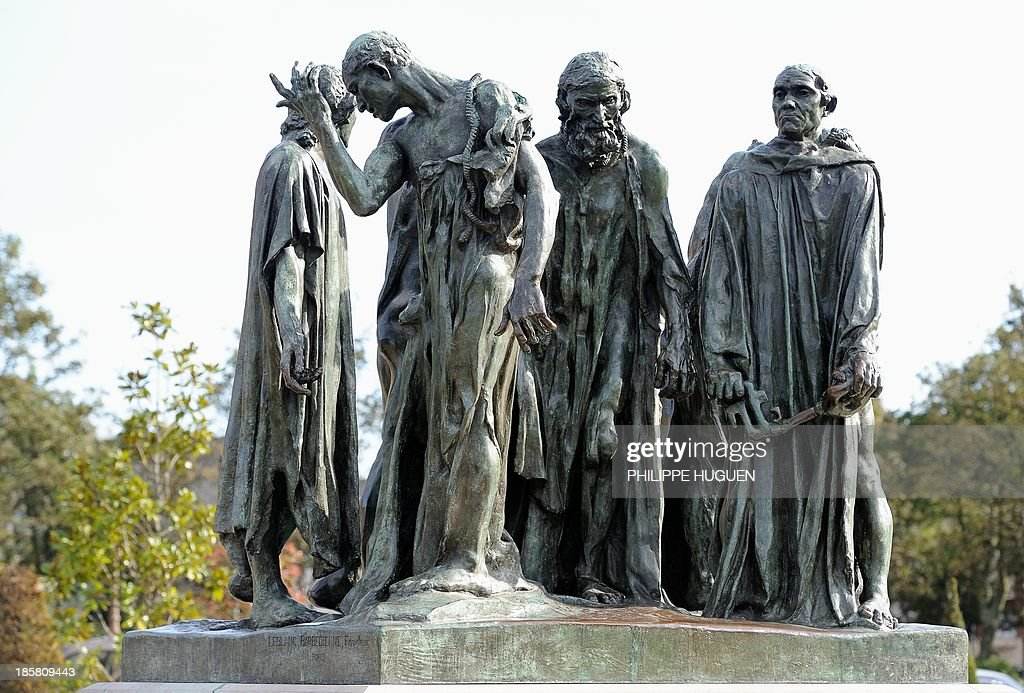 French sculptor Auguste Rodin's 'bourgeois de Calais' are pictured on October 24 2013 in front of the northern France city of Calais' city hall AFP...