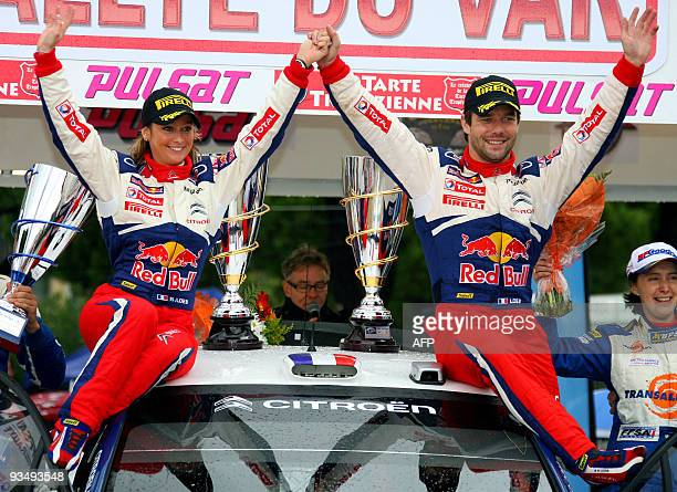 French Sebastien Loeb and his wife Severine celebrate after wining the 55th edition of the 'Rallye du Var' with their Citroen C4 WRC on November 29...