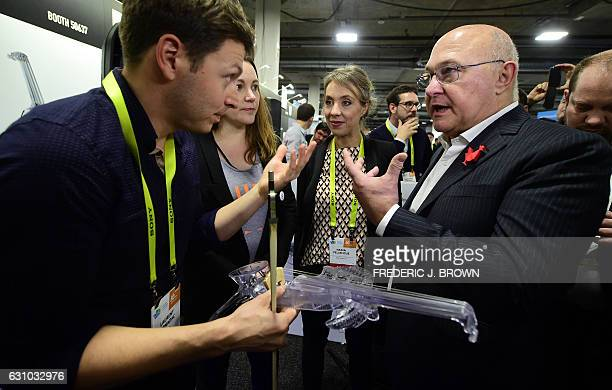 French Secretary of State Axelle Lemaire and Michel Sapin Minister of Economy receive an introduction from Laurent Bernadac to the 3Dvarius electric...