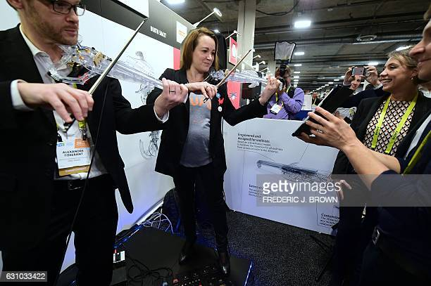 French Secretary of State Axelle Lemaire plays the 3Dvarius electric violin with Laurent Bernadac while visiting French tech booths with Minister of...