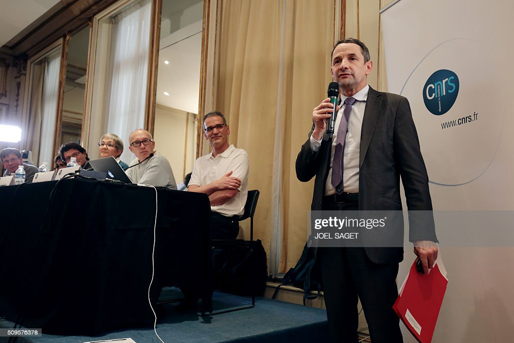 French Secretary of State for Higher Education Thierry Mandon addresses guests of a press briefing of the CNRS (Centre National de la Recherche Scientifique - National Center for Scientific Research) on gravitational wave research by LIGO and VIRGO collaborations in Paris on February 11, 2016. In a landmark discovery for physics and astronomy, international scientists said on February 11 they have glimpsed the first direct evidence of gravitational waves, or ripples in space-time, which Albert Einstein predicted a century ago. / AFP / JOEL SAGET