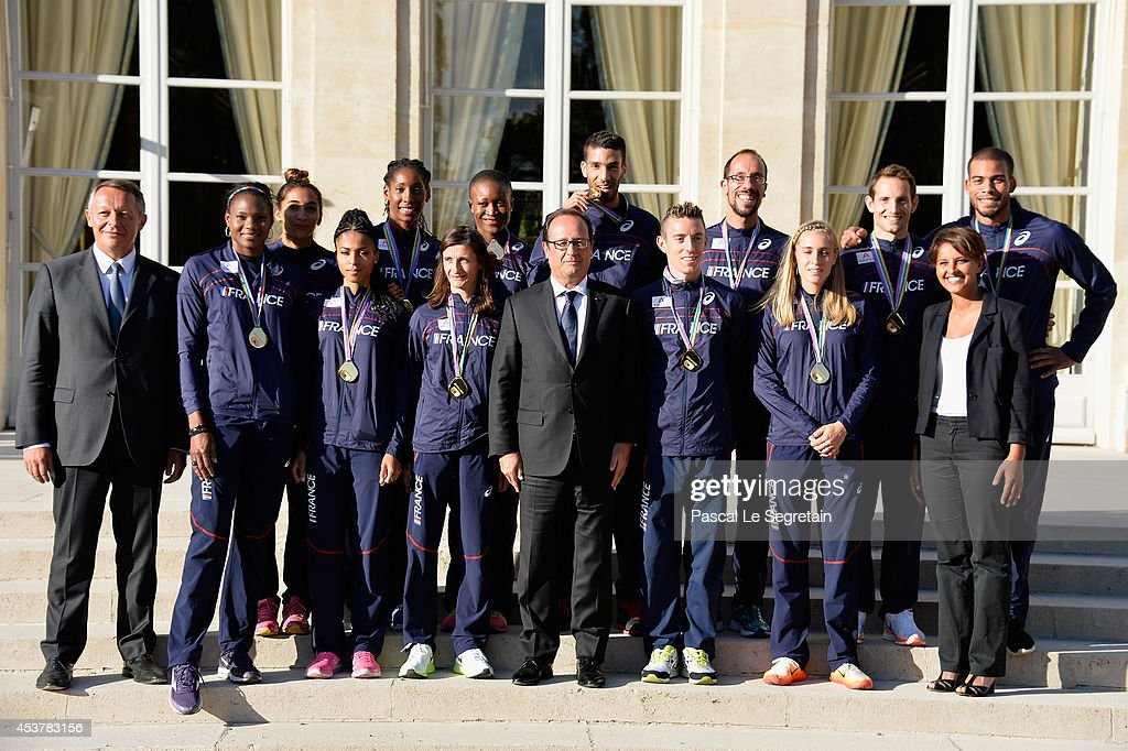 French secretary of state for sports Thierry Braillard (L), French President Francois Hollande (C) and French Minister for Women's Rights, Cities, Sports and Youth <a gi-track='captionPersonalityLinkClicked' href=/galleries/search?phrase=Najat+Vallaud-Belkacem&family=editorial&specificpeople=4115928 ng-click='$event.stopPropagation()'>Najat Vallaud-Belkacem</a> (R) pose with Gold medalists of the French Athletics team at Elysee Palace on August 18, 2014 in Paris, France.