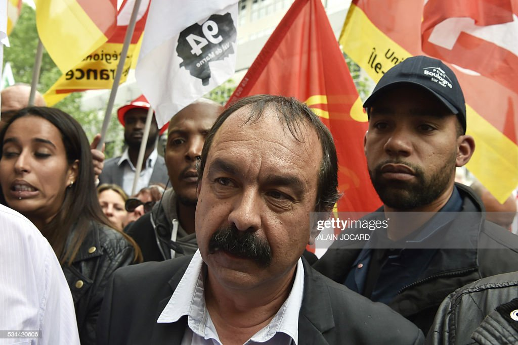 French secretary-general of the General Confederation of Labour (CGT) worker's union, Philippe Martinez takes part in a protest against the government's labour market reforms in Paris, on May 26, 2016. The French government's labour market proposals, which are designed to make it easier for companies to hire and fire, have sparked a series of nationwide protests and strikes over the past three months. / AFP / ALAIN