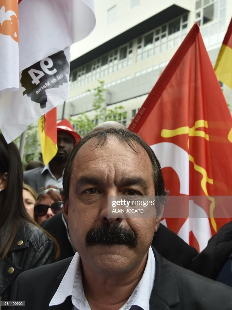 French secretary-general of the General Confederation of Labour (CGT) worker's union, Philippe Martinez takes part in a protest against the government's labour market reforms in Paris, on May 26, 2016. The French government's labour market proposals, which are designed to make it easier for companies to hire and fire, have sparked a series of nationwide protests and strikes over the past three months.