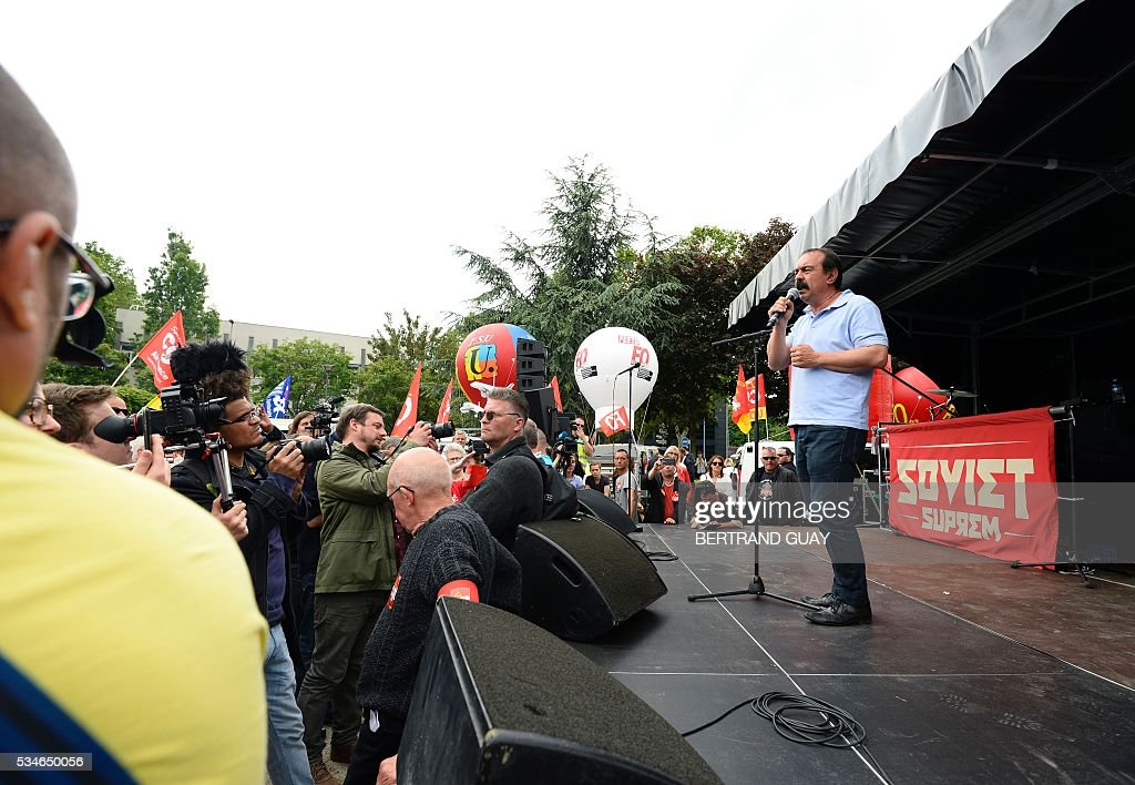 French secretary-general of the General Confederation of Labour (CGT) worker's union, Philippe Martinez speaks on a stage outside the court of Bobigny, northern Paris on May 27, 2016 as the trial of 15 French CGT union's members judged for the episode of the torn shirt was referred to September, in full showdown initiated by the union with the government on labor law. On October 5, 2015 under the cries of naked, naked and resignation , the Air France human resources director found himself shirtless, tattered shirt during a protest after the announcement of a restructuring of the airline threatening nearly 3,000 jobs.