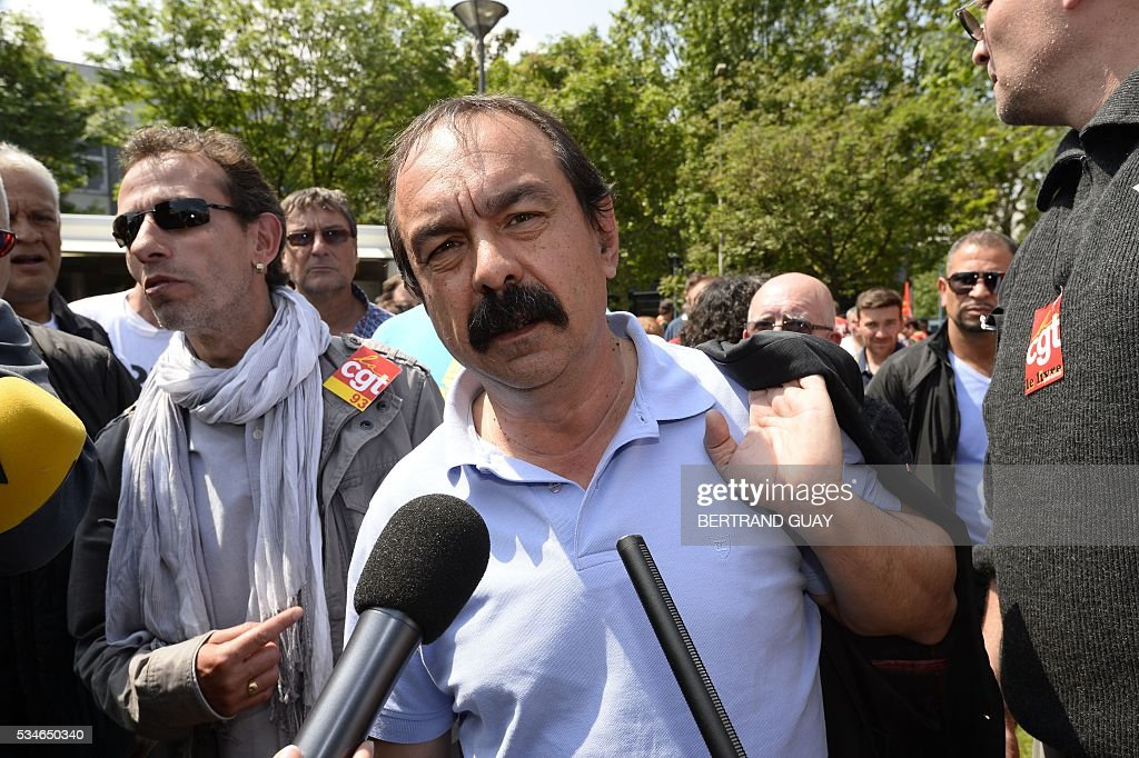 French secretary-general of the General Confederation of Labour (CGT) worker's union, Philippe Martinez speaks to journalists outside the court of Bobigny, northern Paris on May 27, 2016 as the trial of 15 French CGT union's members judged for the episode of the torn shirt was referred to September, in full showdown initiated by the union with the government on labor law. On October 5, 2015 under the cries of naked, naked and resignation , the Air France human resources director found himself shirtless, tattered shirt during a protest after the announcement of a restructuring of the airline threatening nearly 3,000 jobs.