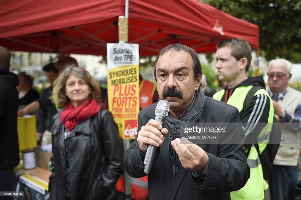French secretary-general of the General Confederation of Labour (CGT) worker's union, Philippe Martinez speaks in Fougeres, western France on May 31, 2016, as he declared that the CGT filed a lawsuit for defamation against the head of France's bosses' federation. French employers' association Medef Pierre Gattaz accused unions of behaving like 'terrorists', as the fresh industrial unrest was set to hit transport just days before fans begin arriving for the start of the football championships on June 10. / AFP / DAMIEN