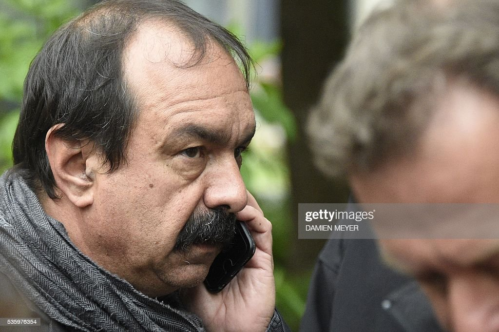 French secretary-general of the General Confederation of Labour (CGT) worker's union Philippe Martinez speaks on the phone in Fougeres, western France on May 31, 2016, as he declared that the CGT filed a lawsuit for defamation against the head of France's bosses' federation. French employers' association Medef Pierre Gattaz accused unions of behaving like 'terrorists', as the fresh industrial unrest was set to hit transport just days before fans begin arriving for the start of the football championships on June 10. / AFP / DAMIEN