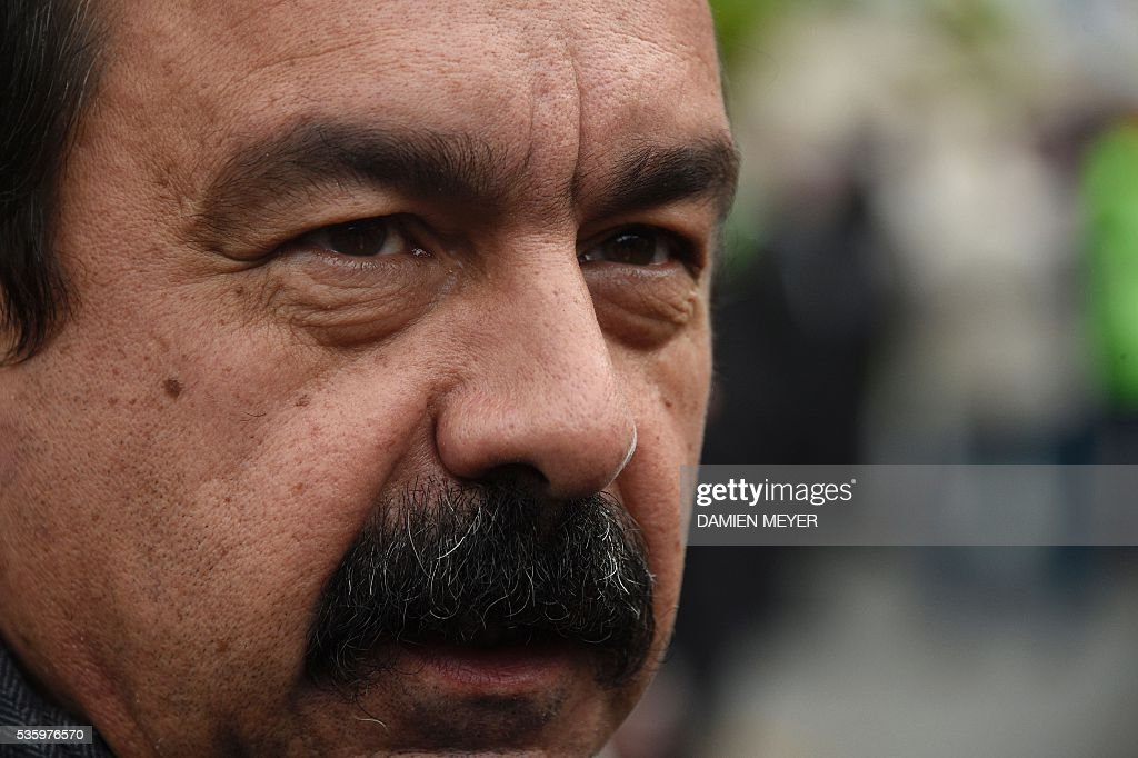 French secretary-general of the General Confederation of Labour (CGT) worker's union Philippe Martinez is pictured in Fougeres, western France on May 31, 2016, as he declared that the CGT filed a lawsuit for defamation against the head of France's bosses' federation. French employers' association Medef Pierre Gattaz accused unions of behaving like 'terrorists', as the fresh industrial unrest was set to hit transport just days before fans begin arriving for the start of the football championships on June 10. / AFP / DAMIEN