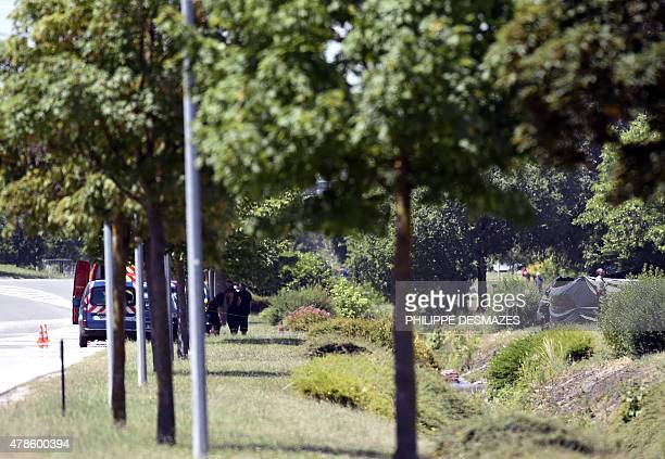 French security gather close to an enclosed area where a decapitated body was found near the Air Products company in SaintQuentinFallavier near Lyon...