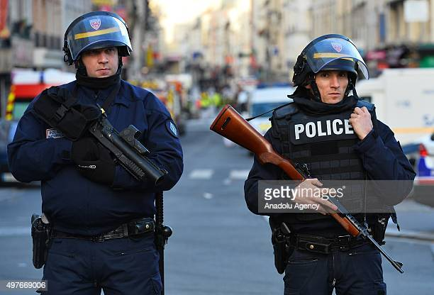 French security guards take up positions after an operation in Saint Denis a northern suburb of Paris on November 18 2015 According to officials a...