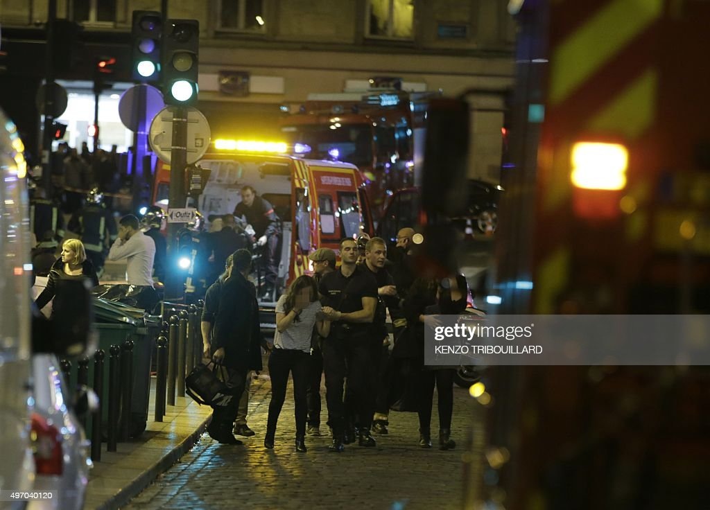 French security moves people in the area of Rue Bichat in the 10th arrondissement of the French capital Paris following a string of attacks on...