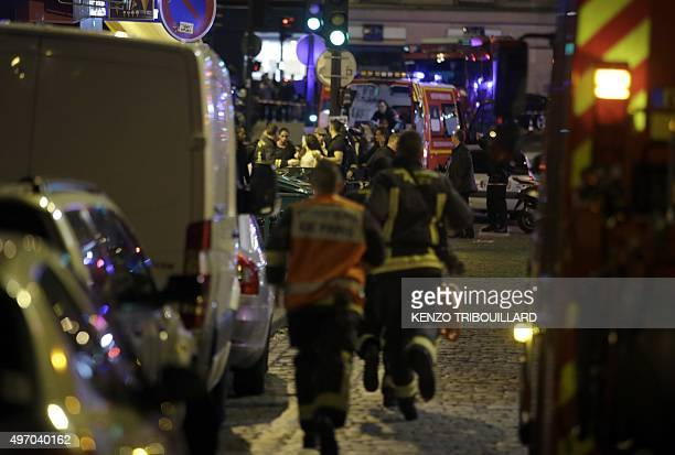 French security rush as people are evacuated in the area of Rue Bichat in the 10th arrondissement of the French capital Paris following a string of...