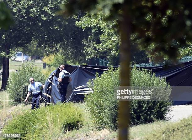 French security stand next to the enclosed area where a decapitated body was found near the Air Products company in SaintQuentinFallavier near Lyon...