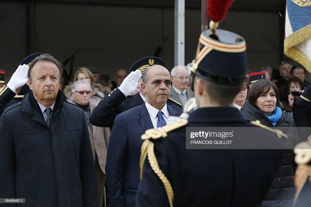 French Senate President Jean-Pierre Bel (L), Deputy Minister in charge of Veteran Affairs Kader Arif (C) and Paris Deputy Mayor Anne Hidalgo (R) attend on March 19, 2013 in Paris a ceremony in memory to the civilian and military victims of the Algerian War of Independence and conflicts in Tunisia and Morocco.