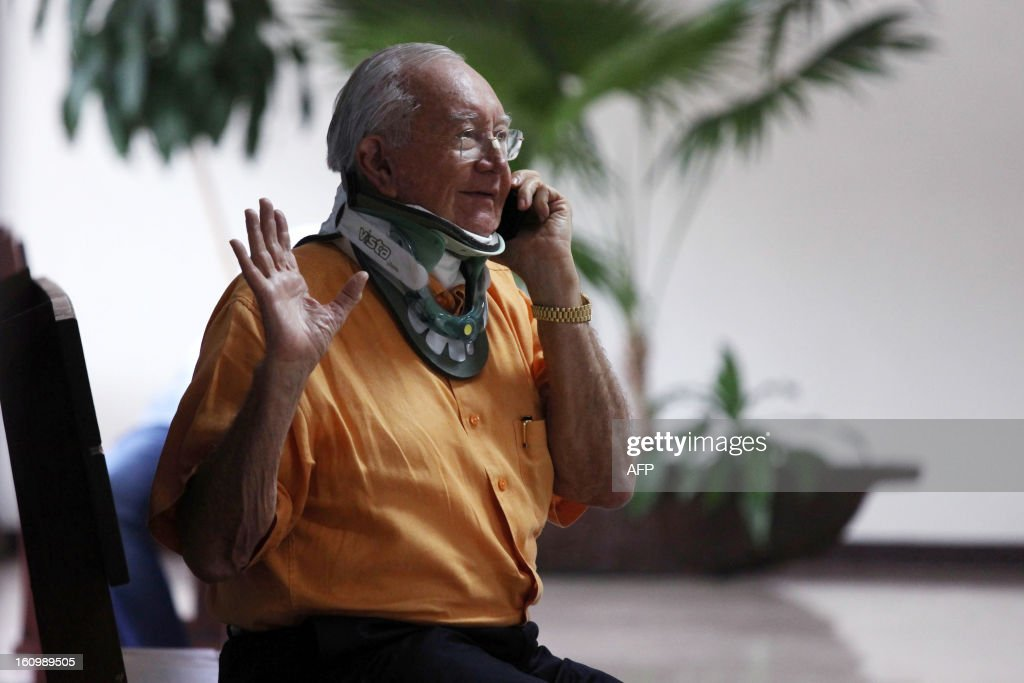 French Senator Gaston Flosse uses a mobile phone at the courthouse at the end of his appeal trial for fictitious jobs, on February 7, 2013 in Papeete, French Polynesia. Flosse was given a suspended sentence for 4 years and was fined 125.000 euros by Papeete's court of appeal regarding the period he was in charge of the territory (1984-2004).
