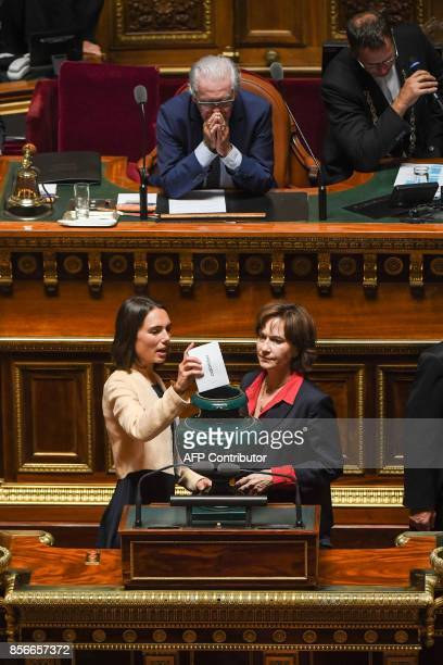 French senator Laurence Rossignol is helped cast his vote by an assistant as French Socialist Senator Philippe Madrelle the Dean of the French Senate...