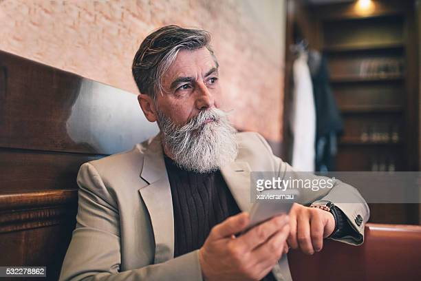 French senior man using a mobile phone