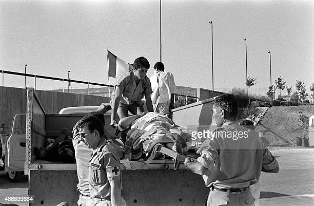 French servicemen unload wounded Palestinians coming from the Palestinian refugee camp of Wihdat from a truck at the French field hospital in Amman...