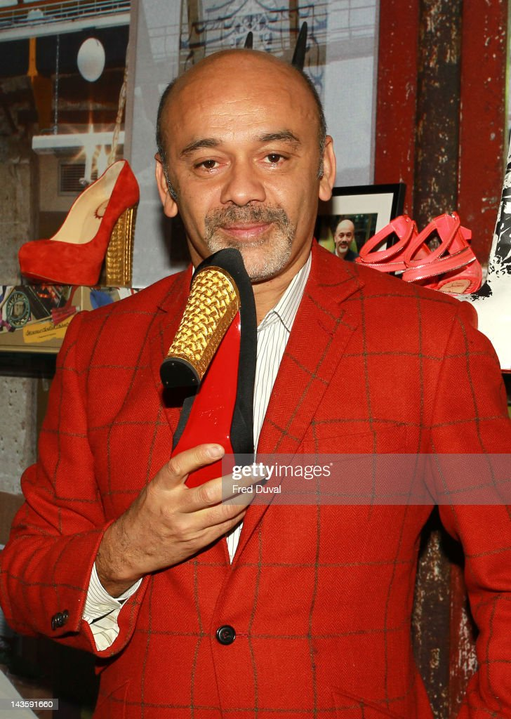 French shoe designer Christian Louboutin attends a preview of an exhibition celebrating 20 years of Christian Louboutin designs at the Design Museum on April 30, 2012 in London, England.