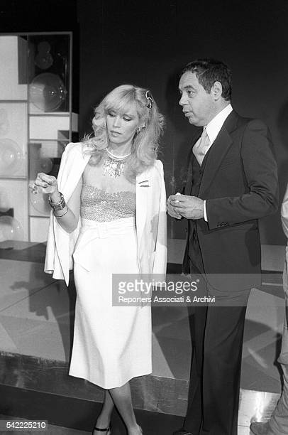 French showgirl Amanda Lear and Italian TV host Gianni Boncompagni talking during the shooting of a TV show 1979