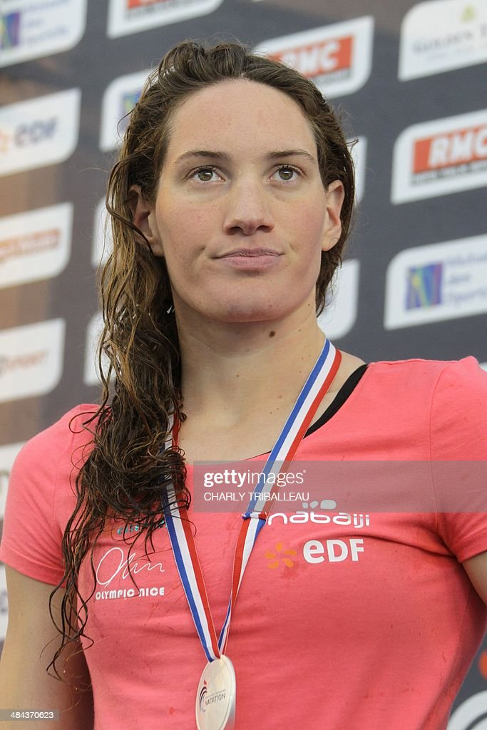 French silver medallist Camille Muffat poses on the podium after the women's 50m freestyle final heat of the French swimming championships in...