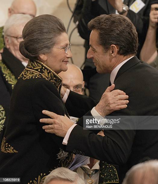 French Simone Veil an Auschwitz survivor and the first elected president of the European parliament is congratulated by French President Nicolas...