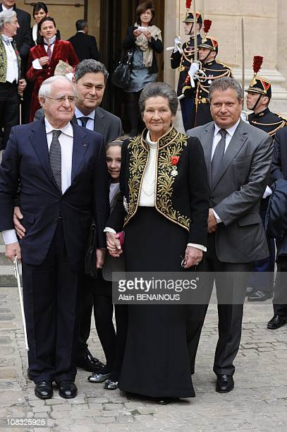 French Simone Veil an Auschwitz survivor and the first elected president of the European parliament poses with her husband Antoine as they leave the...
