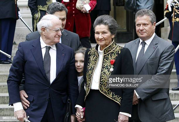 French Simone Veil an Auschwitz survivor and the first elected president of the European parliament pose with her husband Antoine her two sons Jean...