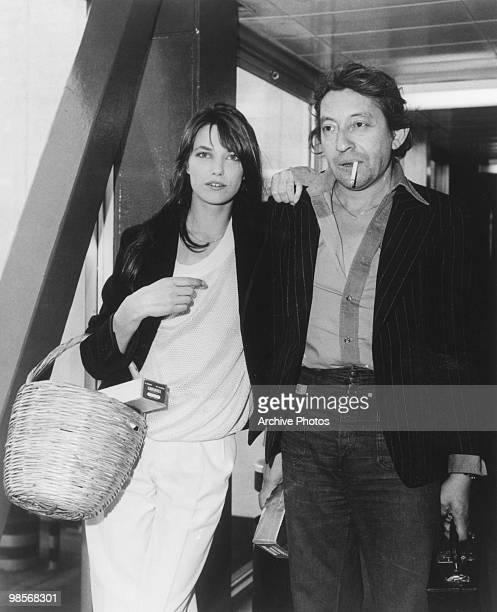 French singer actor and director Serge Gainsbourg with his wife English actress Jane Birkin in London to publicise their film 'Je t'aime moi non...