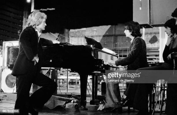 French singer Alain Chamfort prepares for a forthcoming concert at Olympia alongside French singer Claude Francois who gives Chamfort some...