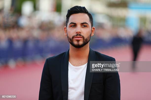 French singer Alban Bartoli poses on the red carpet on September 9 2016 in the northwestern sea resort of Deauville as part of the 42nd Deauville US...
