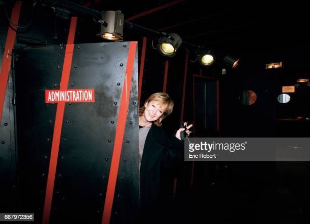 French singer Alice Dona waves from the administration office at the Bobino music hall in Paris Dona took over as the theater's director in 1998