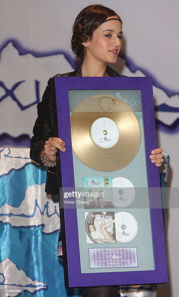 French singer Alizee receives a gold disc for more than 50,000 sales of her album 'Psichédélices' at Plaza Inbursa on June 26, 2008 in Mexico, Mexico City.
