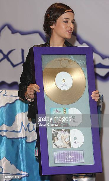 French singer Alizee receives a gold disc for more than 50000 sales of her album 'Psichédélices' at Plaza Inbursa on June 26 2008 in Mexico Mexico...