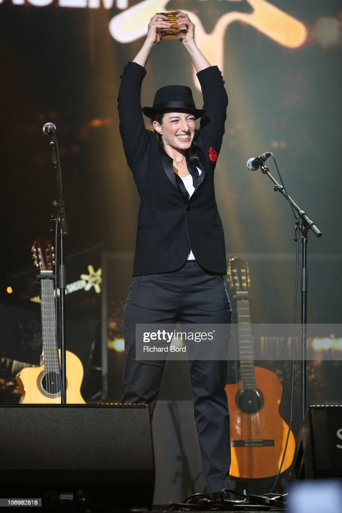 French singer Anais poses onstage as she receives the 'Prix Francis Lemarque' during the 'Grand Prix SACEM 2012' at Casino de Paris on November 26, 2012 in Paris, France.