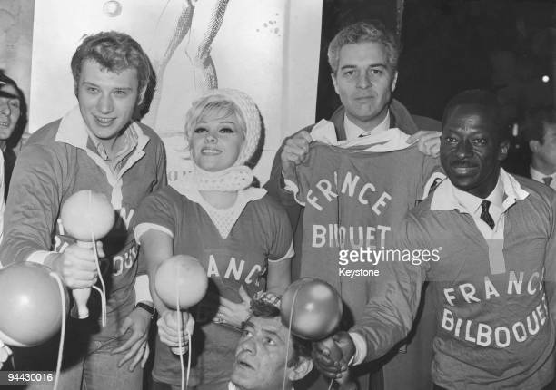French singer and actor Johnny Hallyday attends a bilboquet championship at a Paris club 24th November 1965 From left to right Hallyday Maria Vincent...