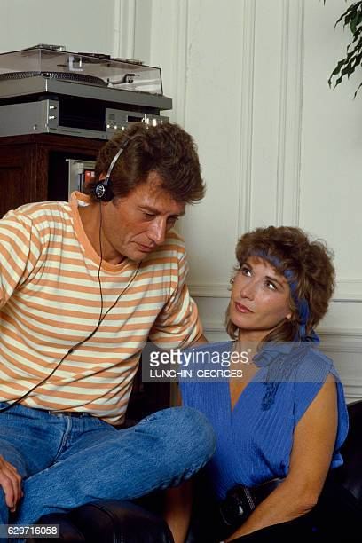 French singer and actor Johnny Hallyday listens to a Marlene Jobert song in a recording studio