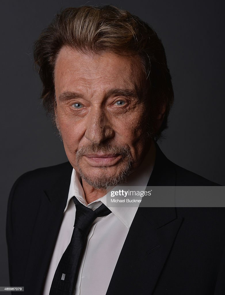 French singer and actor Johnny Hallyday poses for a portait during the 18th Annual City Of Lights, City Of Angels Film Festival at the Directors Guild of America on April 21, 2014 in Los Angeles, California.