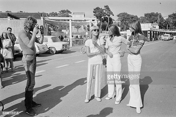French singer and actor Johnny Hallyday taking picture of his wife Bulgarianborn French singer Sylvie Vartan and French singers Sheila and Françoise...