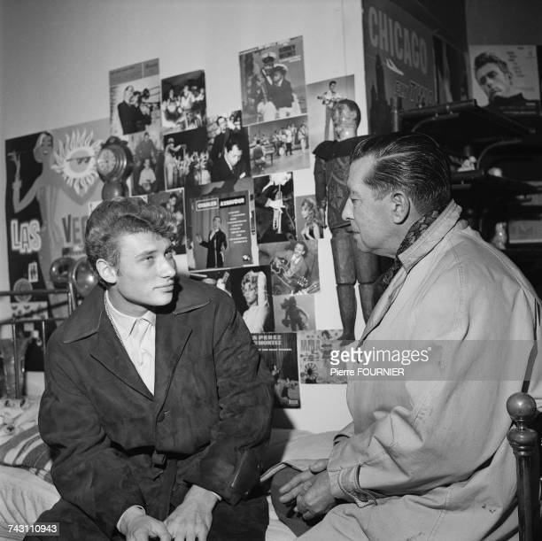French singer and actor Johnny Hallyday with director Marc Allegret on the set of the film 'Les Parisiennes' Paris 20th November 1961