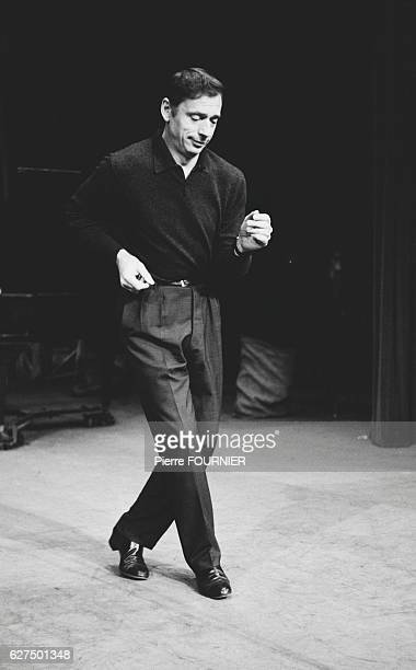 French singer and actor Yves Montand during a rehearsal session at L'Etoile concert hall
