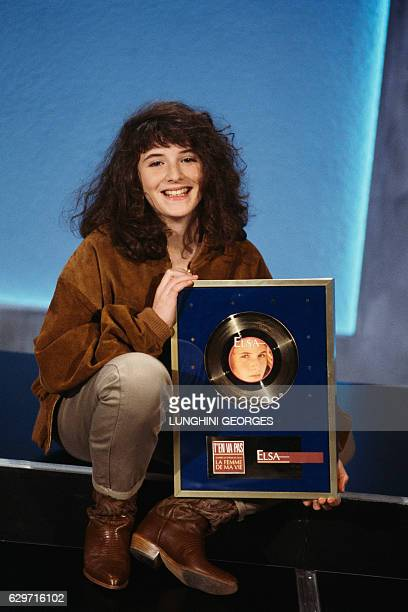 French singer and actress Elsa Lunghini receives a gold disc for her song T'en va Pas composed by Romano Musumarra for French director Régis...